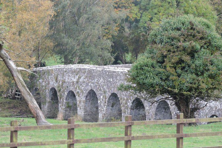 A stone bridge over the river boyne beside bective abbey